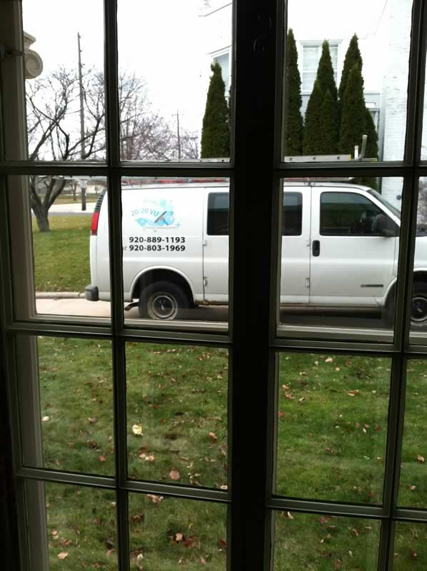 The 20/20 VU, LLC van through freshly cleaned windows!